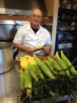 Larry preps corn.JPG